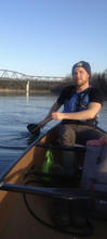 Photo of Conor Kerr paddling a canoe
